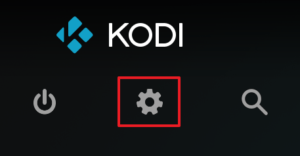 Capture d'écran de l'application Kodi, bouton système représenté par une roue dentée.